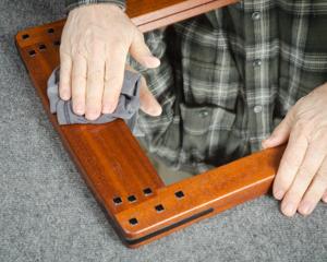 polishing a mirror mohagany mirror frame