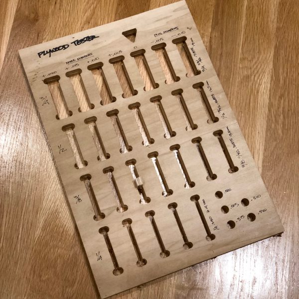 Plywood Thickness Tester - a single panel with cut outs for sizing plywood